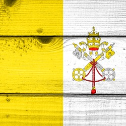 Vatican City flag painted on old wood plank background. Brushed natural light knotted wooden board texture. Wooden texture background flag of Vatican City