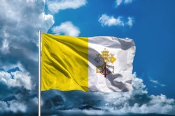 Vatican City flag with sky background