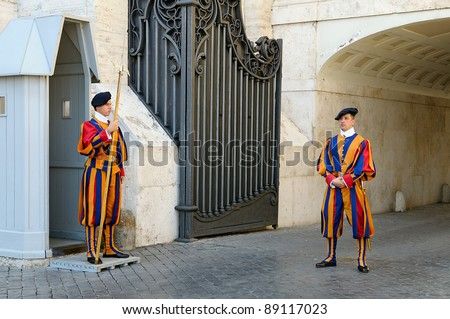 VATICAN CITY, ITALY - SEPTEMBER 15: A pair of Papal Swiss guards stand guard at the entrance of Saint Peter's Basilica on September 15, 2011. Swiss Guards in their traditional uniform.