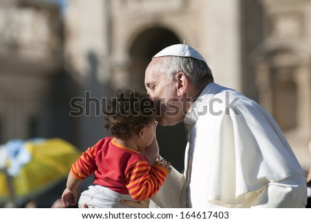 Vatican City - November 06. Pope Francis on the popemobile kiss child in St. Peter's Square on november 6 2013