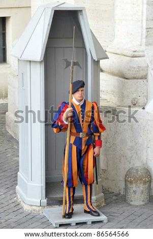 VATICAN CITY, ROME - CIRCA SEPTEMBER 2011: Swiss Guard standing with a halberd circa September 2011 in Vatican City. Vatican City State is a sovereign city-state within the city of Rome