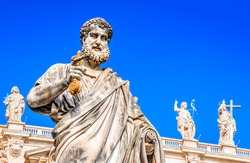Vatican City, Rome, Italy. Statue of Saint Peter and Saint Peter's Basilica at background in St. Peter's Square.
