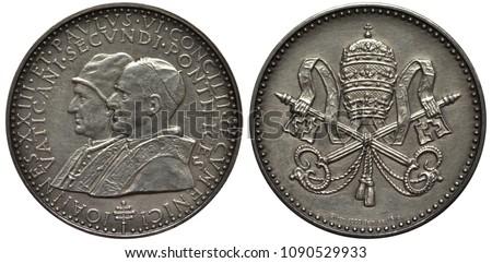 vatican city token depicting...