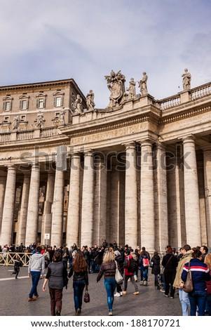 VATICAN CITY, VATICAN - DECEMBER 23: Tourists at Saint Peter\'s Square on December 23, 2013 in Vatican City, Vatican. Saint Peter\'s Square is among most popular pilgrimage sites for Roman Catholics.