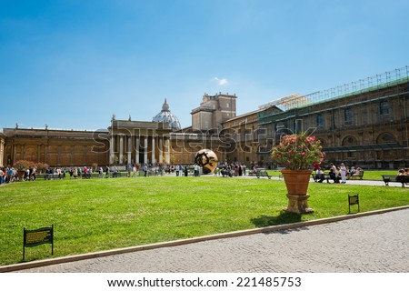VATICAN CITY, VATICAN - JULY 15 2014: People around Sphere within sphere in Courtyard of the Pinecone at Vatican Museums. Sphere was created in 1990 by Italian sculptor Arnoldo Pomodoro.