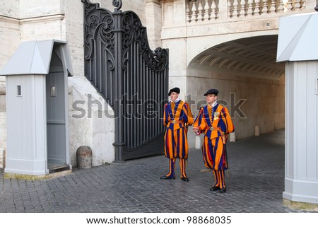 VATICAN CITY, VATICAN - MAY 11: Famous Swiss Guard surveil basilica entrance on May 11, 2010 in Vatican. The Papal Guard with 110 men is the world's smallest army. - stock photo