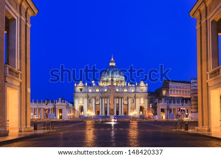 Vatican Italy Rome state of religion Christianity landmark biggest cathedral St Peter and square entrance from city street at sunrise highlighted lights and illumination