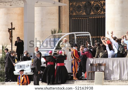 VATICAN - MARCH 31: Pope Benedict XVI blessed people during a pre-easter mass at Saint Peter's square on March 31, 2010 in Vatican.