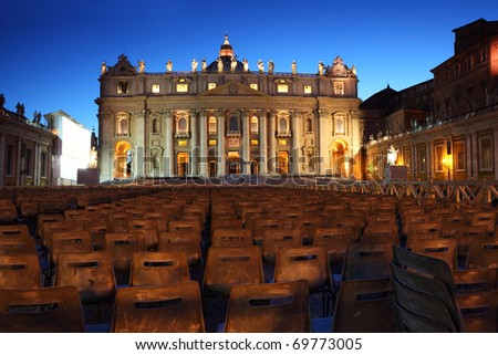 Vatican Museum in Basilica of St. Peter and  rows of gray chairs at evening in Rome, Italy