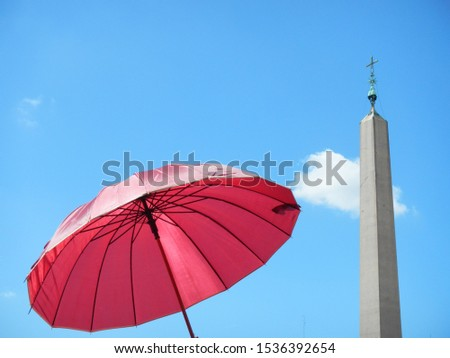 Vatican obelisk with cross and pink sunshade on sunny day in Vatican in Rome in Italy #1536392654