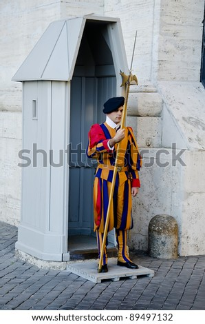 VATICAN - OCTOBER 14: Famous Swiss Guard in Vatican on October 14, 2011. Pontifical Swiss Guard of Vatican City is the world's smallest army.