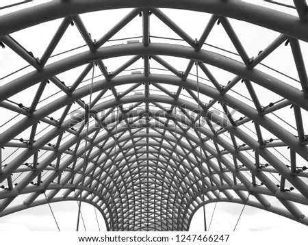 free photos the glass roof with triangle metal structure frame Metal Pole Transparent vault construction of metal pedestrian bridge 1247466247