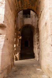 Vaulted corridor leading into the darkness of the Amphitheatre of El Jem, Tunisia.
