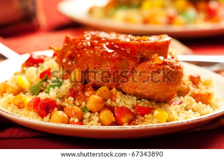 veal braised in a harissa sauce with chick peas and couscous