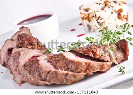 Veal tenderloin stuffed with cherries and rice
