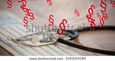 Vector icon of section symbol against close-up of keyboard with stethoscope #1045054180