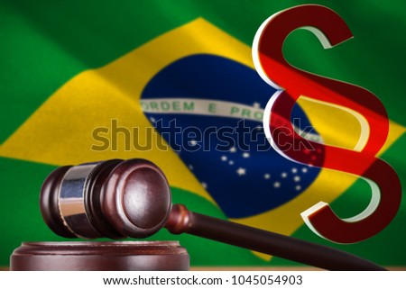 Vector icon of section symbol against digitally generated brazil national flag #1045054903