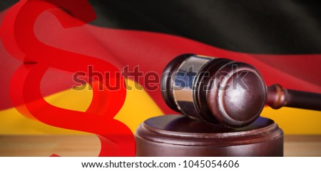 Vector icon of section symbol against digitally generated german national flag #1045054606