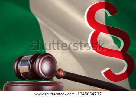 Vector icon of section symbol against digitally generated nigerian national flag #1045054732