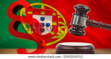 Vector icon of section symbol against digitally generated portugese national flag #1045054552