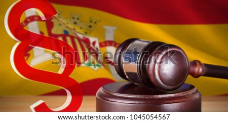 Vector icon of section symbol against digitally generated spanish national flag #1045054567