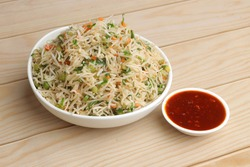Veg fried rice, Veg biryani served in white bowl on wooden background