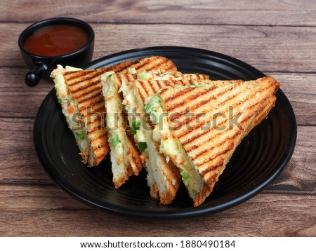 Veg grilled sandwich served with ketchup, isolated over a rustic wooden background, selective focus Foto stock ©