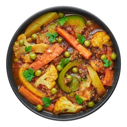 Veg Kolhapuri in black bowl isolated on white. Indian vegetable curry dish. Vegetarian asian food and meal.