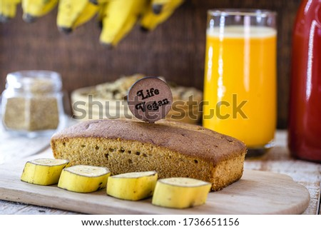 Photo of vegan banana bread with the English phrase: Vegan life. Healthy, gluten-free food without animal products.