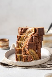 vegan buckwheat banana bread stacked on ceramic plate. Healthy vegan dessert. copy space. vertical image