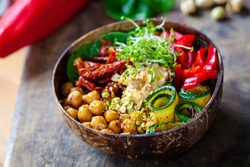 Vegan Buddha bowl with chickpeas, courgette, sundried tomatoes and sprouts