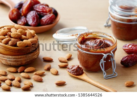 Vegan date spread with almonds (sugar-free). Jar of homemade vegan date spread. #1385644526