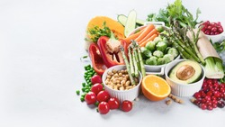 Vegan diet food. Selection of rich fiber sources vegan food.Foods high in plant based protein, vitamins, minerals, anthocyanins, antioxidants. Image with copy space