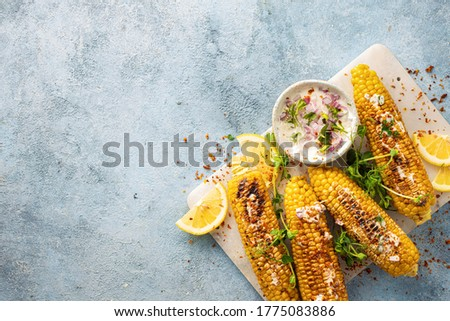 Vegan dinner with grilled sweet cob corn top view with copy space Summer vegetarian snacks Stock photo ©