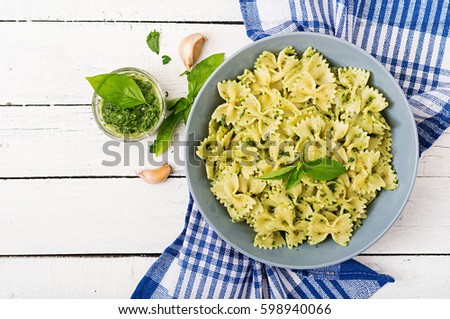 Vegan  Farfalle pasta in a basil-spinach sauce with garlic. Top view. Flat lay
