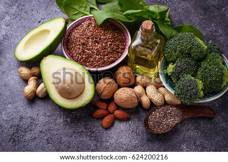 Vegan fat sources  flax, spinach, broccoli, nuts, olive, oil and avocado. Concept of healthy food #624200216