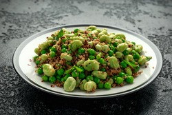 Vegan Green broad beans and quinoa salad with sweet peas and mint. Healthy food.