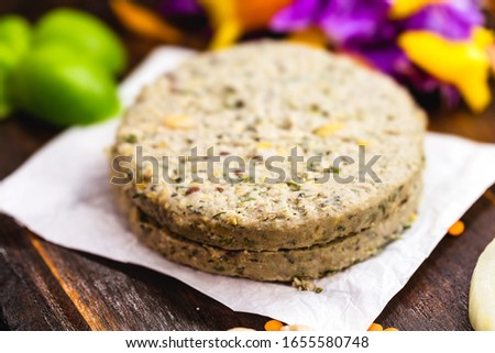 vegan hamburger based on various vegetables and various types of soy or chickpeas, without frying, on a rustic wooden background.Concept of healthy vegetarian meal and vegan food.