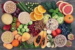Vegan health food concept for a high fibre diet with fruit, vegetables, cereals, whole wheat pasta, grains, legumes & herbs. Foods high in antioxidants, s & vitamins. Immune boosting. Flat lay.