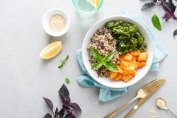 Vegan healthy lunch bowl with quinoa, sauteed kale and baked butternut squash, top down view