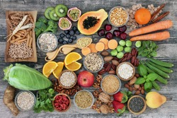 Vegan high dietary fibre and immune boosting health food  with fruit, vegetables, whole wheat pasta, legumes, cereals, nuts and seeds with foods high in omega 3, antioxidants, anthocyanins, vitamins.