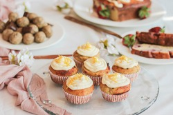 Vegan lemon cheesecake cupcakes and other healthy treats on a white table