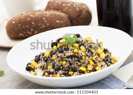 Vegan meal of mixed quinoa with corn and black beans.
