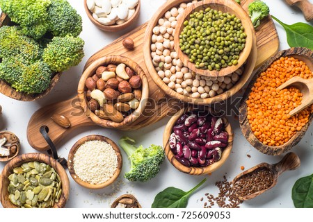 Vegan protein source. Beans, lentils, nuts, broccoli spinach and seeds. Top view on white table. Healthy vegetarian food. ストックフォト ©