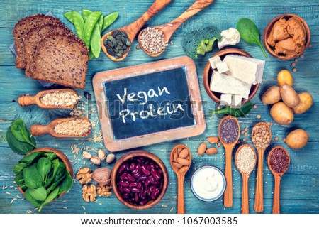 Vegan protein sources. Top view on a blue wooden background #1067003585
