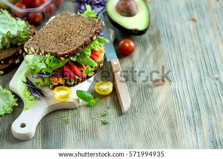 Stock Photo Vegan rye sandwich with fresh avocado, salad,veggies, healthy snack, vitamin and diet food