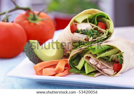 Vegan sandwich wrap with Lavish bread made from flax, oats and whole wheat. Stuffed with fresh spinach, sprouts, mushrooms, red peppers and avocados for a healthy lunch.