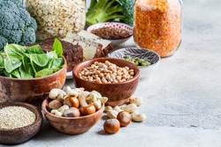 Vegan sources of protein background. Tofu, chickpeas, lentils, nuts, spinach and broccoli are vegetable proteins.