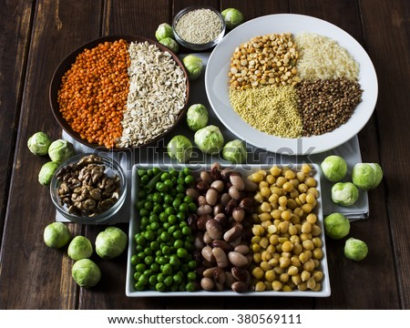 Shutterstock Vegan sources of protein: grains, lentil, beans, nuts and Brussels sprouts on a dark wooden table