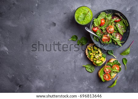 Vegan/vegetarian dinner background. Vegetable salad, sandwiches, fresh green smoothie. Healthy eating concept. Detox diet/plan. Space for text. Top view. Vegetarian lunch. Weight loss. Cleanse program